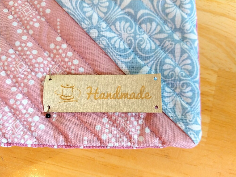 How to Make a Quilted Throw Pillow: Post 5: Sew the Pillow - leather label - Wunderlabel